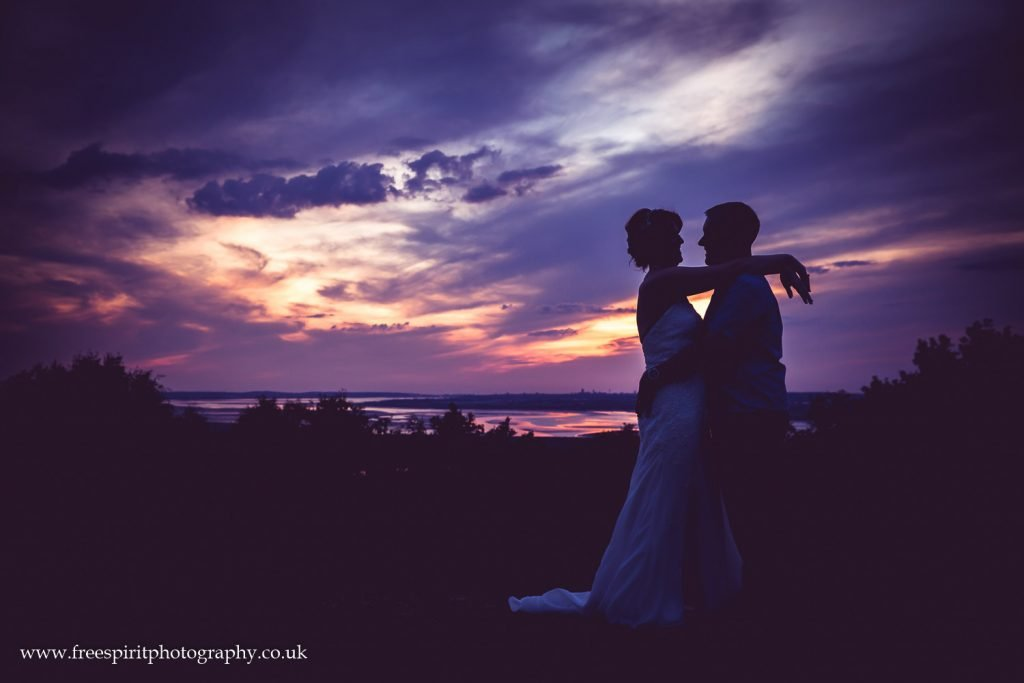 Sunset on Frodsham Hill. Silhouette of Bride and Groom.